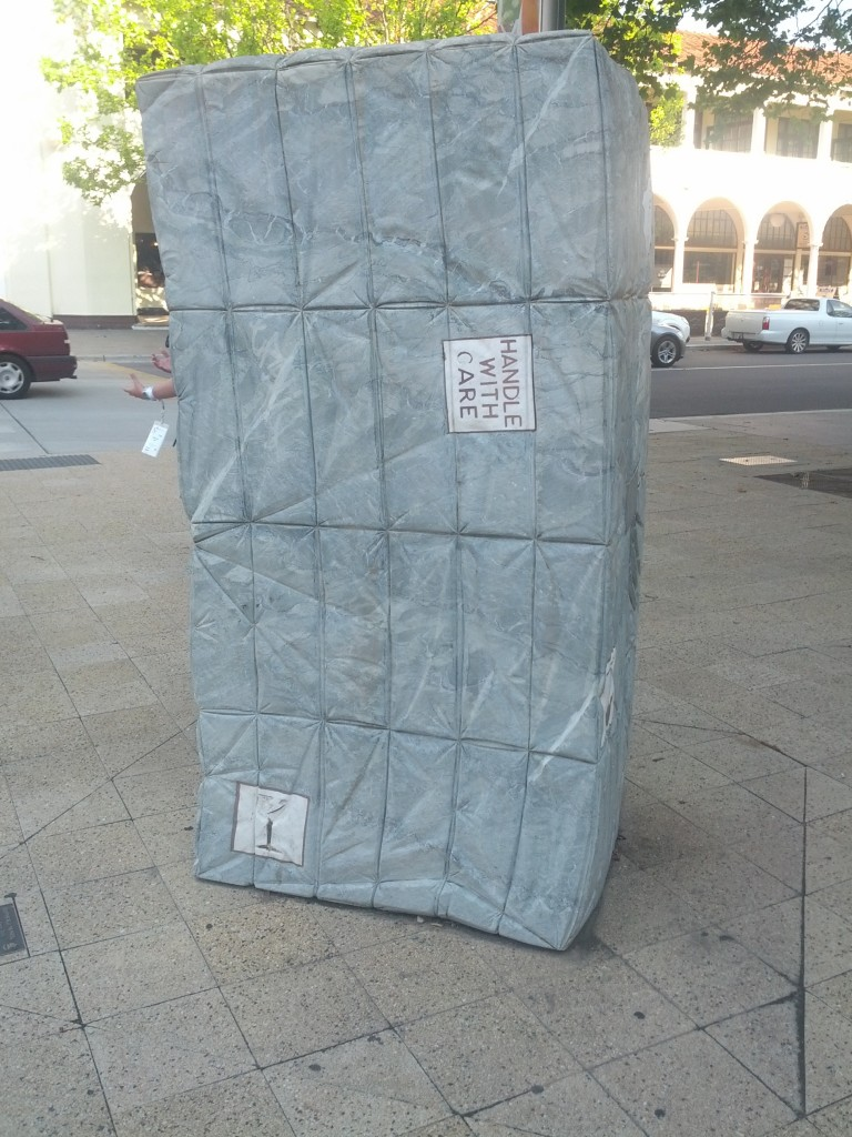 Either I've already had too many beers, or there's a giant stone parcel in my way.