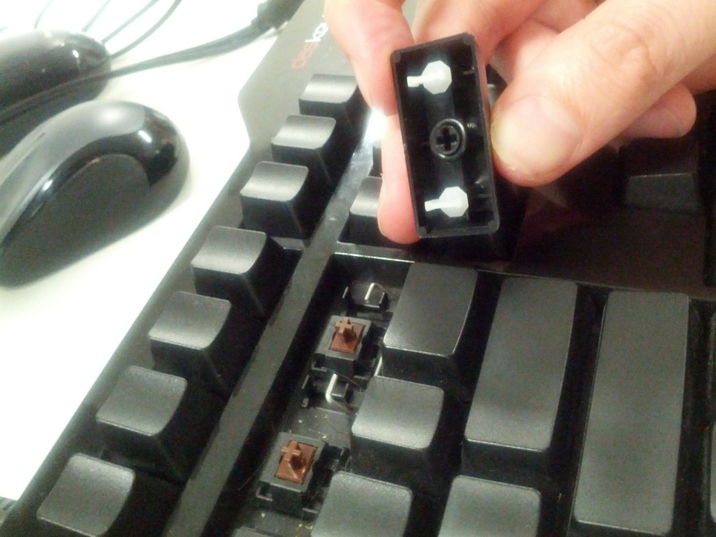 The tricky keys - don't just pull them off, unless you want to break the white plastic loops.